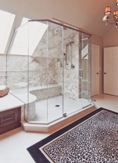Glass surrounding large shower.  It looks gorgeous, a pain in the butt to keep sparkling clean.  I know... My bathroom has similar shower. If u have anyone but u and ur mate, don't do this!!!  U will regret it. xo