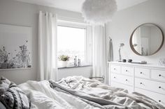 White bedroom with Ikea 'Hemnes' dressers & 'Stockholm' mirror