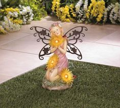 "This pretty fairy statue will make your garden or yard more beautiful, day and night. When the sun's out, you'll enjoy her intricate detailing and iron wings. By night, the three yellow daisy blooms she holds will light up, powered by the built-in solar panel. Item weight: 1.4 lbs. 9¾"" x 5″ x 11½"" high. …"