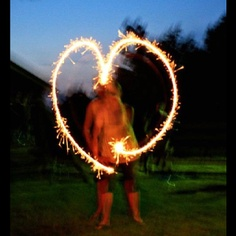Camera trick: Slow down your shutter speed to a few seconds and make shapes with sparklers... Fun!!