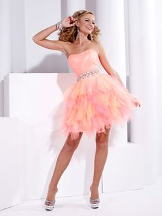 Beautiful Hannah S Prom Dress 27716. This tulle prom dress features a strapless neckline, pleated and fitted bodice, and gorgeous beaded waistband. Completing the look of this prom dress is a full ruffled skirt. Cute and affordable dress perfect for your 2013 prom.