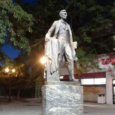 Lincoln Square, Chicago, Illinois — by throwingsofas. Abe Lincoln statue at the end of Lincoln Square.