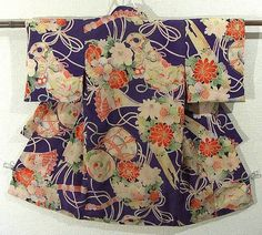 This is a vintage kimono for girls with traditional musical instruments and seasonal flowers pattern, which is dyed