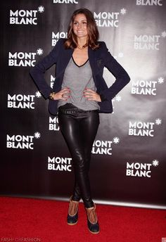 """Olivia Palermo- navy blue blazer, gray t shirt, black leather or coated denim pants, and """"duck"""" boots."""