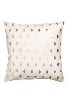 Housse de coussin à motif: Housse de coussin en coton avec motifs dorés variés devant et dans le dos. Fermeture à glissière dissimulée.