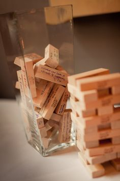 A game of Jenga used as a guest book! Love it! Super cool idea!