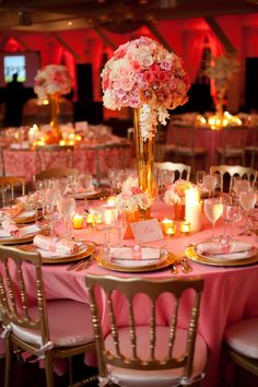 Reception tables: the tall vase will have pink and white orchids and will have two smaller vases with cut orchids in water with floating candle. Votives will be included.