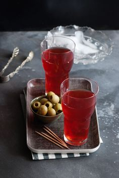 Elizabeth Minchilli's Shaken Campari. Vodka, Campari, lemon juice, and pomegranate molasses.