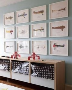 Wall color - white framed art. 14 bodacious baby boy nurseries. Love this wall color, white framed art, storage with colorful bins