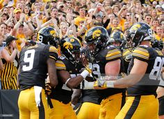 Running back Akrum Wadley #25 of the Iowa Hawkeyes celebrates with wide receiver Jerminic Smith #9 and offensive lineman Sean Welsh #79 after scoring a touchdown during the second quarter against the Miami (OH) RedHawks on September 3, 2016 at Kinnick Stadium in Iowa City, Iowa.
