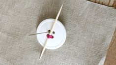 Use a Toothpick to Sew Buttons to Sit Properly