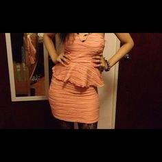 Peplum bodycon dress Coral pink peplum dress.NWOT.never been worn. Dresses