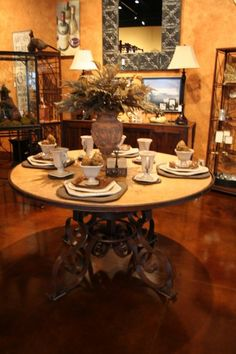 beautiful stone and iron table set with GG Collection tableware.