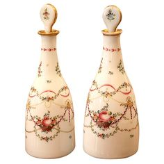 Pair of Louis XVI Opaline Decanters  France  circa 1780's  Pair of exceptional French Louis XVI period hand blown opaline decanters with hand painted and gilt decoration, original stoppers, circa 1780