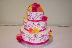 Orange and pink themed wedding cake