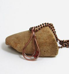 Handcrafted copper wire teardrop pendant with Swarovski Indian Red crystal accents.  The design is hand formed, hammered and polished then given a patina for an antique look.    Designed by BDJ Design