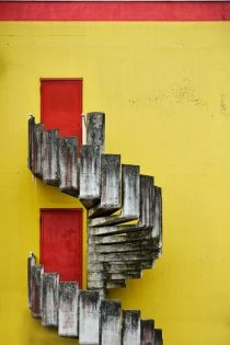 Could you imagine walking up these stairs on your way home? This gray, winding staircase is given that extra pop from the bright colours of the doors and walls. Concrete Stairs, Take The Stairs, Stair Steps, Stairway To Heaven, Staircase Design, Windows And Doors, Red Doors, Doorway, Stairways