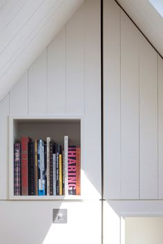 "Hampstead loft conversion by Alexander Martin features ""a new twist on the hidden library door""."