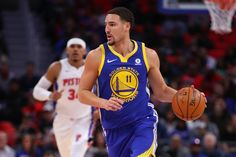 Klay Thompson (11) of the Golden State Warriors brings the ball up the floor in front of Tobias Harris (34) of the Detroit Pistons during the first half at Little Caesars Arena on Dec. 8, 2017, in Detroit. (Photo by Gregory Shamus/Getty Images)