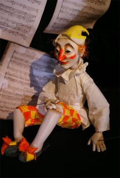 Petrushka is a stock character of Russian folk puppetry (rayok) known at least since 17th century. Petrushkas were used as marionettes, as well as hand puppets. Traditionally he was a kind of a jester distinguished by red dress, red kolpak, and often a long nose.