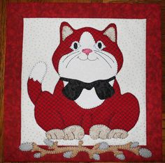 Cat quilted applique wall hanging.