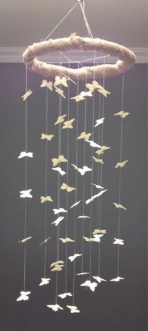 Ivory butterfly and burlap decorative nursery mobile.