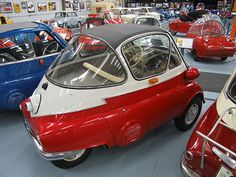 """1956 BMW Isetta 300. This car is a rare surviving European Bubble Window model. This body style preceded the Sliding Window model that was introduced in 1957. It also has the highly desireable """"Z-Mold"""" Trim and 2-tone paint."""