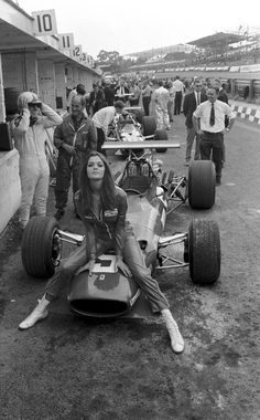 pinterest.com/fra411 #vintage #formula1 - BRITISH GRAND PRIX 1968 (Brands Hatch A lovely pit babe sits on the Chris Amon's Ferrari 312 nose. Image by © Sutton Motorsport Images / Luca Tameo Collection.