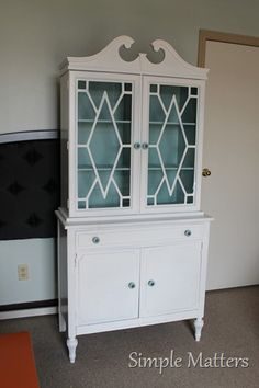 white and aqua vintage hutch