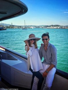 'Sundays': Olivia and her handsome husband relaxed on deck while taking in the air