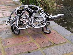 Made from thrown away metal, looks like mostly horse shoes.