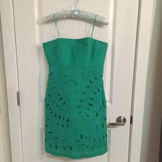 Turquoise Eyelet Dress Strapless eyelet dress with pleated bust. 100% cotton. Zipper back. Tabitha Dresses Strapless