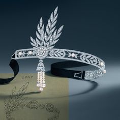 The Great Gatsby (2013) | The Savoy headpiece from Tiffany & Co. worn by actress Carey Mulligan (Daisy Buchanan) | More Gatsby here: http://mylusciouslife.com/historical-style-the-great-gatsby-the-1920s-style-flapper-fashion/
