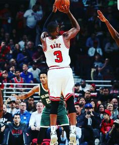 Chicago native and new Bull Dwyane Wade shoots the jumper against the Bucks in a preseason game in Chicago.