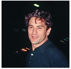 A young Robert De Niro... Look at that handsome face.