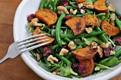 Sweet Potato and Green Bean Salad with Maple-Mustard Dressing  This roasted sweet potato salad is the perfect meatless Monday main (talk about a tongue twister!). Toss the taters with green beans, mixed leafy greens, toasted walnuts, and dried cranberries for a meal that packs a punch without much prep.