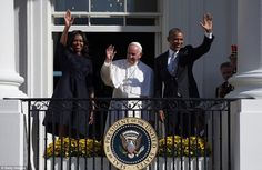 The president, First Lady, and pope wave to the crowds after their speeches before mass at St Matthew's Cathedral