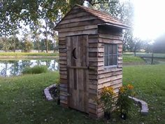 """I made this """"Outhouse"""" looking structure for a neighbor so that he could cover his aeration pump and store his pond supplies. He supplied the windows on the two sides, I supplied the lumber from skid material. The Cedar was…"""