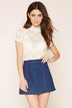 Style Deals - A sheer knit floral lace top featuring short sleeves and a mock neckline with twin button-loop closure in the back above a keyhole cutout.