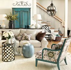 .Love the classic furniture, the updated peacock color and fabric on the chair and the black geometric table.