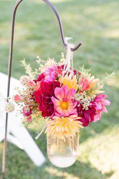 Bright aisle florals | Photography: Gavin Farrington Photography - gavinfarrington.com  Read More: http://www.stylemepretty.com/california-weddings/2014/04/30/rustic-fall-wedding-at-thomas-fogarty-winery/