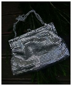 Modern mesh - classic style clutch bag with kiss lock clasp. Purchased for $4.00 while op shopping.