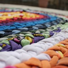 Upcycle t-shirts into a fun and vibrant braided rug!