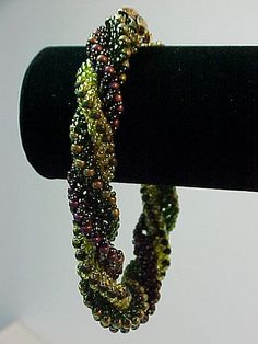 Supple beadwoven triple spiral bracelet woven on a core of size 10 Delica beads.  I strung the Delica beads on beading wire to give the bracelet extra strength.