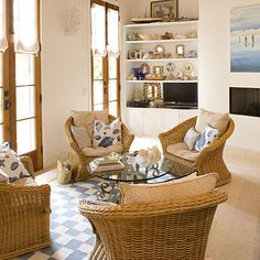 Coastal and nautical touches abound in this family room beginning with the seashell-print pillows. Coastal artwork over the fireplace flanks shelving that is filled to the brim with shell frames and boxes.  http://www.southernliving.com/home-garden/decorating/beach-home-decorating-00400000066279/page11.html