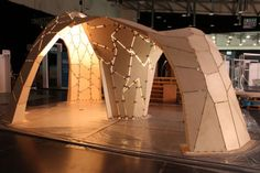 Ramboll's Trada Pavilion, a plywood structure inspired by the efficient curved forms of Frei Otto and Heinz Isler, at the Timber Expo 2012.