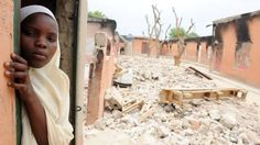 Boko Haram has attacked many schools in northern Nigeria -A female student stands in a burnt classroom at a school in Maiduguri, Nigeria, on 12 May 2012