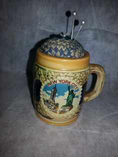 Pincushion in a vintage NYC cup https://www.etsy.com/listing/167968020/pincushion-in-a-tiny-new-york-mug-unique