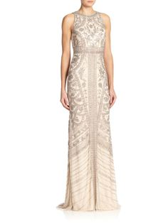 """Allover intricate beading instantly elevates this floor-sweeping column gown for a glamorous evening-ready look. Halter necklineSleevelessConcealed back zip closureLinedAbout 45"""" from natural waistNylonSpot cleanImported"""