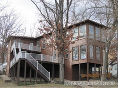 Perfect! This custom designed lakefront property is pristine and ready to go. New roof in 2017! Great lake views from both levels as windows abound in this beauty. Just off the main channel on Gravois Arm with deep water. 6000 lb hoist included on dock with swim platform. Sunroom area off master w/hot tub and another just off living area. Gas fireplace in living area accented by vaulted ceilings and a beautifully windowed hurricane-styled kitchen with views all around in Gravois Mills MO